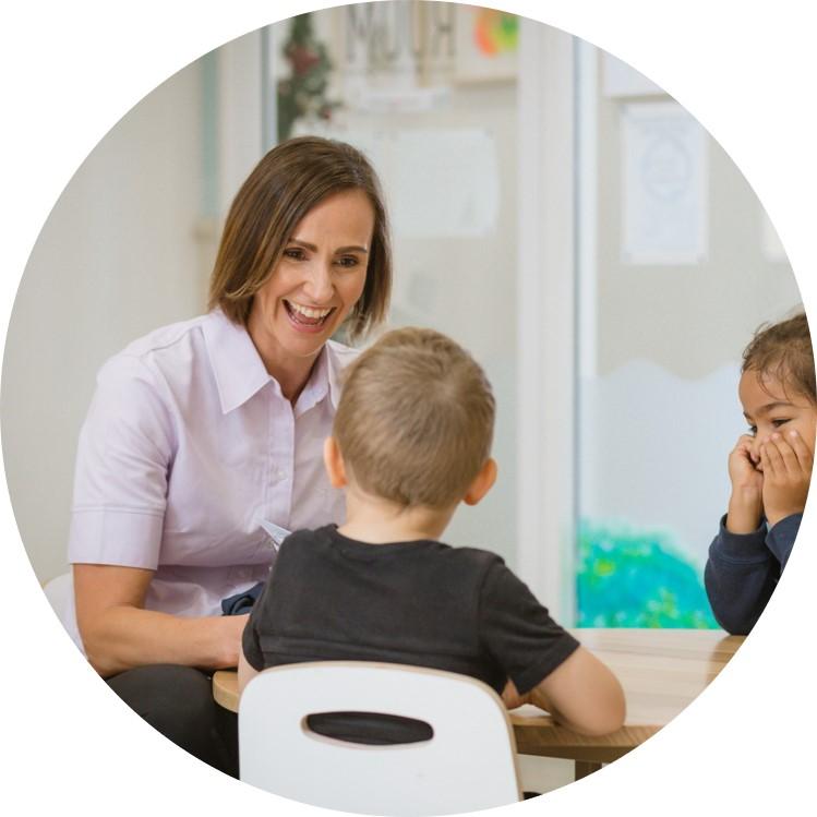 Speech therapist building communication skills in children